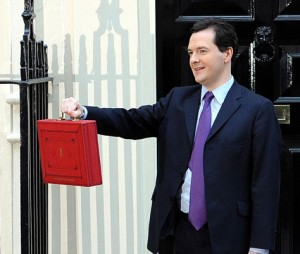 Chancellor of the Exchequer George Osborne holds up his ministerial red box on the steps of 11 Downing Street before heading to the House of Commons to deliver his Budget Statement; PA copyright