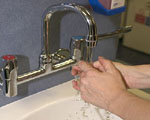 washing hands in a hospital sink