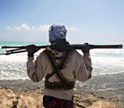 Armed pirate keeping vigil along the coastline in Somalia (getty images)