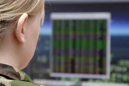 woman monitoring computer screen