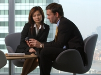 Man and woman talking in an office.