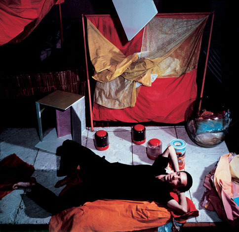 c.1965. Hélio Oiticica with 'Bólides and Parangolés' in his studio in Rio de Janeiro