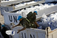 UN peacekeepers distribute water and food in Haiti, credit UN photo