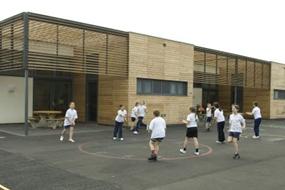 Children in playground sports lesson