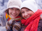 Two young women wrapped up warm