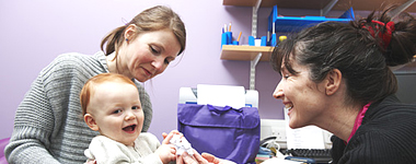 GP treating a mother and child
