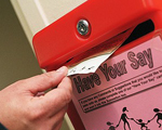 Survey being posted into letter box