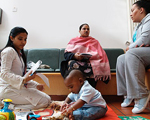 Mothers with children in waiting room
