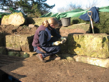 Chiselling a rock by hand