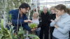 Kew Horticulturist showing visitors an orchid