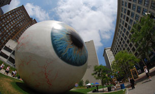 Image of eyeball statue in city