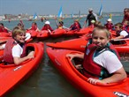 Children in kayaks at Weymouth Beach Festival