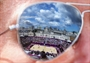 Beach Volleyball court is reflected in a pair of sunglasses