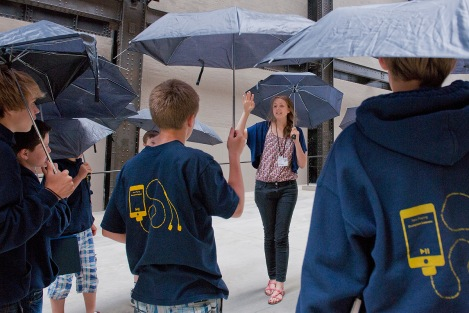 School group at Tate Modern holding umbrellas