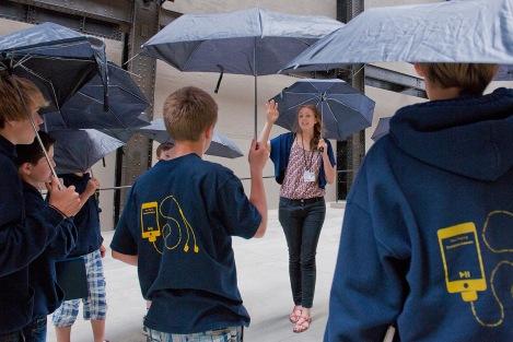 School group at Tate Modern holding umbrellas