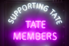 Neon sign outside the Members Room at Tate Britain