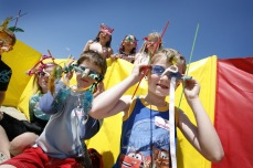 Six children wearing sunglasses they have decorated themselves