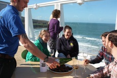 Visitors enjoying wine and snacks on the rooftop terrace of the Cafe at Tate St Ives