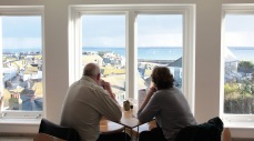 Visitors in the Café at Tate St Ives looking out on the old town