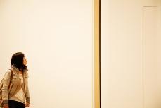A visitor looking at an artwork at Tate Modern