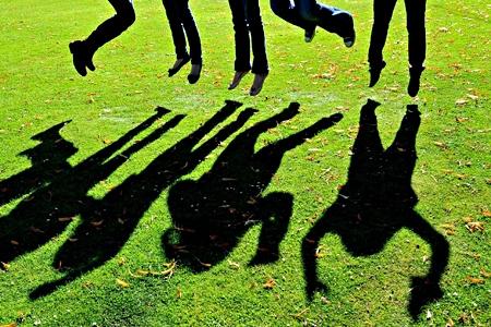 People jumping. Photo: PA.