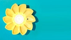 A light in the shape of a yellow flower