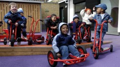 Young children playing in their nursery playground