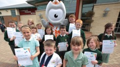 Wenlock with students at Dundonal Primary school, NI