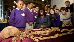 Children view a skeleton on the Olympic Park site