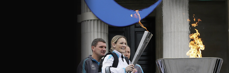 Claire Lomas lights the cauldron -credit PA
