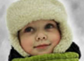 Close up of young child wearing warm fleecy hat