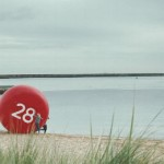 Stoptober campaign button on beach