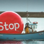 Boat carrying huge red stop button