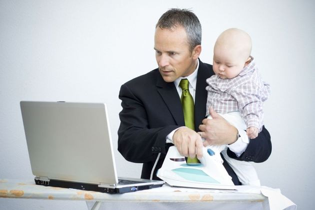 Businessman juggling work and baby