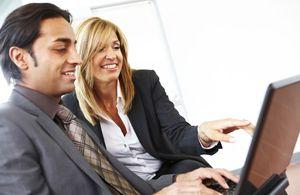 Businesswoman mentors young male entrepreneur