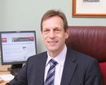 David Harper at desk