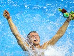 Tom Daley of Great Britain celebrates finishing third in the men's 10m Platform Diving final