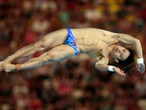Bo Qiu competes in the men's 10m Platform Diving