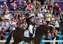 Charlotte Dujardin of Great Britain celebrates with her gold medal