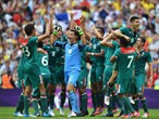 Mexico players celebrate after winning gold in the Men's Football Final