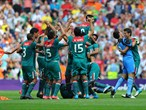 Mexico players celebrate victory over Brazil