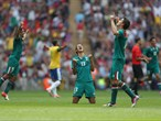 Diego Reyes of Mexico falls to his knees and celebrates winning gold