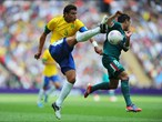 Thiago Silva of Brazil battles for the ball with Marco Fabian of Mexico