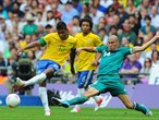 Alex Sandro of Brazil battles for the ball with Jorge Enriquez of Mexico