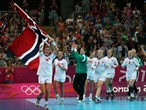 Katrine Lunde Haraldsen of Norway celebrates with her team mates after winning the gold medal