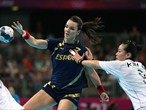 Beatriz Fernandez Ibanez of Spain passes the ball against Kim Cha Youn of South Korea