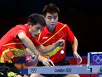 Zhang Jike and Wang Hao of China competing in the men's Team Table Tennis