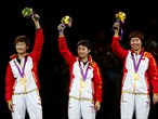 Ding Ning, Guo Yue and Li Xiaoxia of China celebrate on the podium