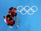Feng Tianwei of Singapore congratulates her teammates