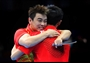 China celebrate defeating the Republic of Korea for gold in the men's Team Table Tennis